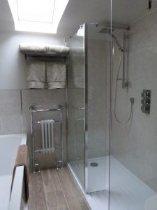 Eldroth House Barn bathroom showing walk in shower bath and towel radiator