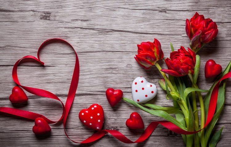 Hearts and red tulips