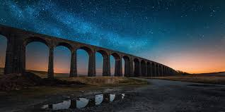 Ribblehead viaduct at night showing starry sky